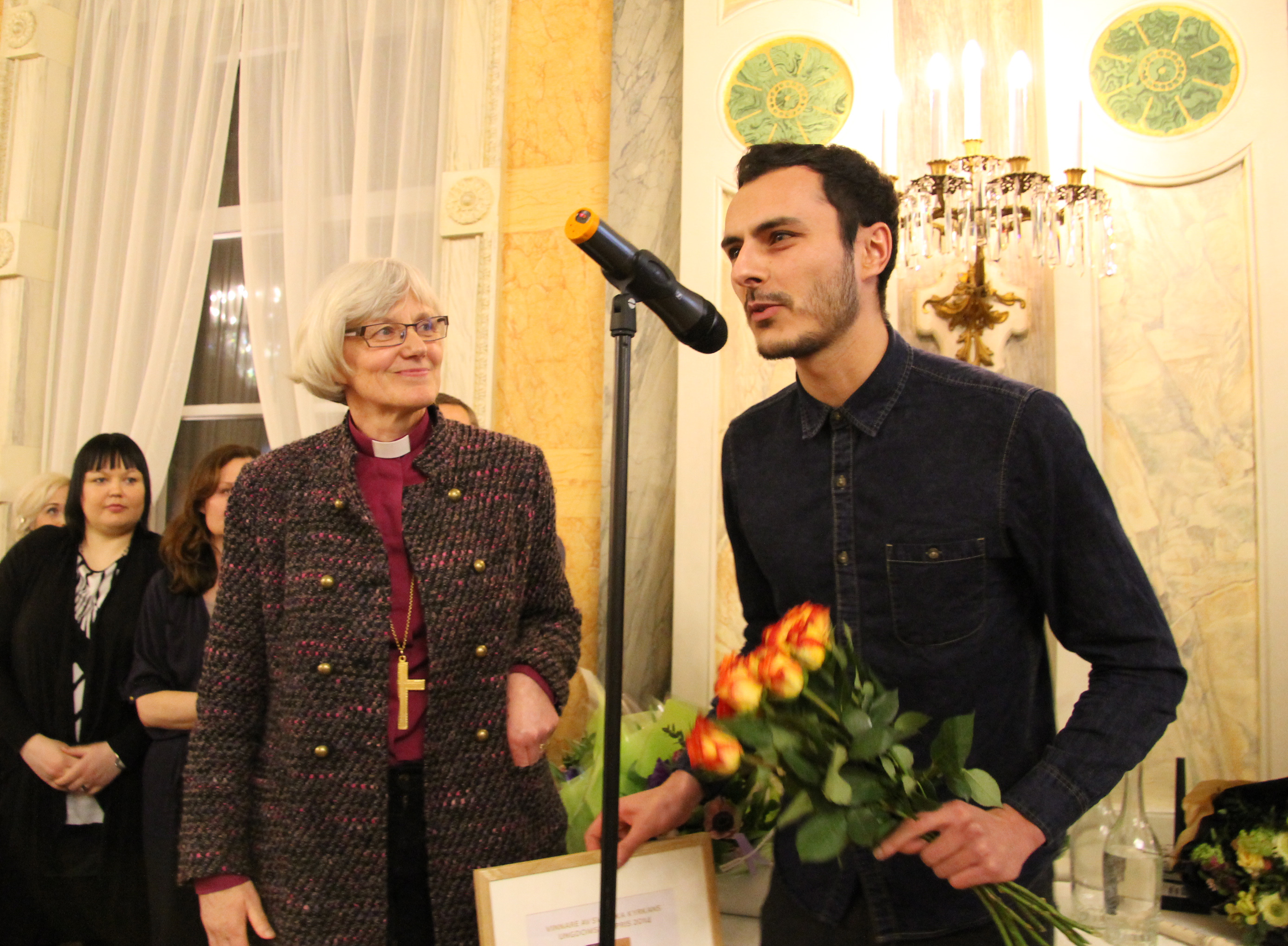 Bishop Antje Jackelen presenting Noof Ousellam with the award for Best Film at the BUFF Film Festival in Sweden. Photograph by Maria Lundström